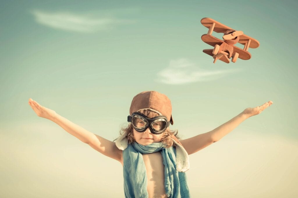 Child with Airplane Toy